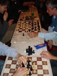 r-photons in a chess cafe