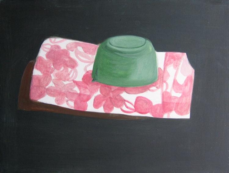 Groen potje op roze stof
